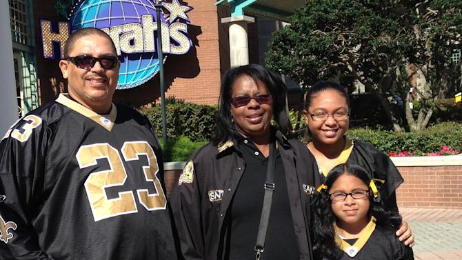 New Orleans residents Stephen Boudy, left, Shiela Jones, center, Camry Boudy, top right, and Sequoia Boudy, lower right, sport Saints jerseys in New Orleans on Saturday, Feb. 2, 2013. Saints jerseys are such a staple on the streets of New Orleans this week, you'd think they're playing in the Super Bowl. The city hosts NFL football's Super Bowl XLVII between the San Francisco 49ers and Baltimore Ravens on Sunday. (AP Photo/Nancy Armour)