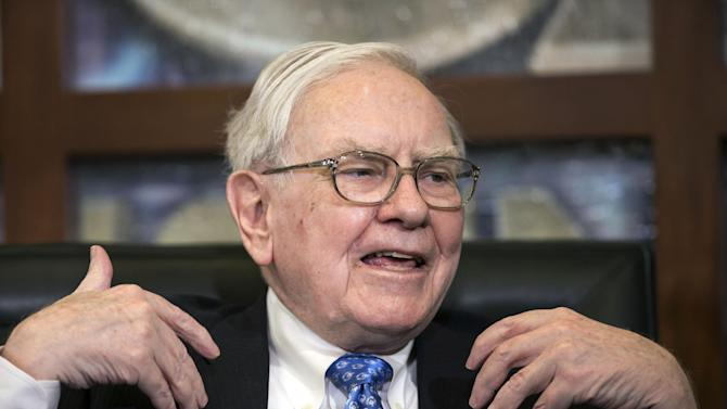 Berkshire Hathaway CEO and Chairman Warren Buffett speaks during an interview with Liz Claman of the Fox Business Network, in Omaha, Neb., Monday, May 6, 2013. The Berkshire Hathaway shareholders meeting took place over the weekend. (AP Photo/Nati Harnik)