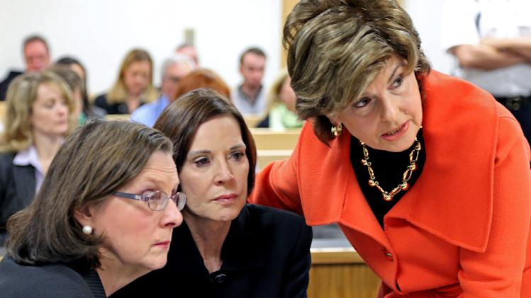 CORRECTS NAME TO MAUREEN SULLIVAN STEMBERG, NOT MAUREEN STEMBERG SULLIVAN - Maureen Sullivan Stemberg, center, flanked by lawyers Linda Ouellette, left, and Gloria Allred, is seen in Norfolk Probate Court Thursday, Oct. 25, 2012. in Canton, Mass. A Massachusetts judge will allow the release of testimony by GOP presidential candidate Mitt Romney in the decades-old divorce of Staples founder Tom Stemberg.    (AP Photo/Mark Garfinkel, Pool)