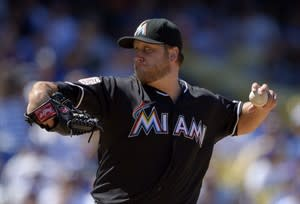 Miami Marlins starting pitcher Mark Buehrle throws to the plate during the fifth inning of their baseball game against the Los Angeles Dodgers, Sunday, Aug. 26, 2012, in Los Angeles. Newly acquired left-hander Buehrle says he's looking forward to moving on with his career as a member of the Toronto Blue Jays. THE CANADIAN PRESS/AP-Mark J. Terrill