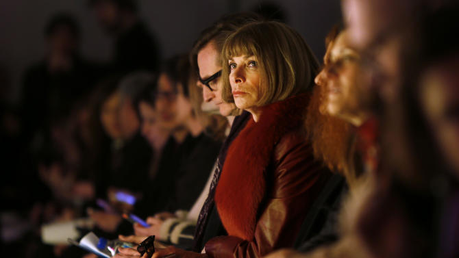 Fashion editor Anna Wintour sits in the front row before the Rodarte Fall 2013 collection show during Fashion Week, Tuesday, Feb. 12, 2013 in New York. (AP Photo/Jason DeCrow)