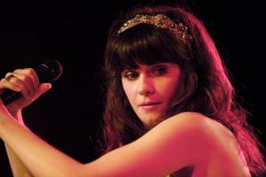 She sings, she writes, she acts . . . what can't Zooey Deschanel do?