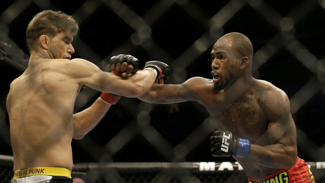 Bobby Green punches Josh Thomson during the first round of a  lightweight mixed martial arts bout at a UFC event in San Jose, Calif., Saturday, July 26, 2014. Green won by split decision