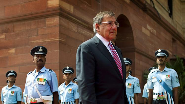 FILE - In this Wednesday, June 6, 2012 file photo, U.S. Defense Secretary Leon Panetta, center, inspects Indian troops during a welcoming ceremony at the Ministry of Defense in New Delhi, India. The U.S. and Pakistan are starting to look more like enemies than friends, threatening the U.S. fight against Taliban and al-Qaida militants based in the country and efforts to stabilize neighboring Afghanistan before American troops withdraw. Secretary of Defense Leon Panetta raised the temperature this past week by joking during a trip to Pakistan's archenemy India about how the U.S. didn't tell Islamabad about the covert Navy SEAL raid that killed Osama bin Laden last year in a Pakistani garrison town. Pakistani officials were infuriated they were kept in the dark, and the country's army was humiliated that it wasn't able to stop the American operation.(AP Photo/Jim Watson, Pool, File)