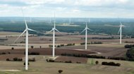 Wind turbines between Poitiers and Angouleme in France. The World Bank said a planet that is four degrees warmer would see food production slashed, species eradicated, more frequent heat waves and high-intensity cyclones, and diseases spread to new areas