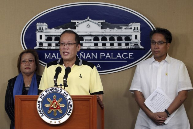 President Benigno Aquino (C), is flanked by his cabinet members during a news conference at the Malacanang presidential palace in Manila February 26, 2013. Aquino appealed on Tuesday to the former Sultan of Sulu Jamalu Kiram III to convince his followers to return home and end the two-weeks standoff but at the same time warned the government may take legal action against him. Around 200 armed men who said they are followers of the Sultan of Sulu , remained at a coastal village on the eastern Malaysian state of Sabah as Philippines and Malaysian authorities work out a peaceful means to resolve the two-weeks standoff that threatens the two countries diplomatic relations. In photo from (L-R): Justice Secretary Leila de Lima, President Aquino and Manuel Roxas, Interior and Local Government Secretary.  REUTERS/Malacanang Presidential Palace/Handout (PHILIPPINES - Tags: POLITICS) FOR EDITORIAL USE ONLY. NOT FOR SALE FOR MARKETING OR ADVERTISING CAMPAIGNS. ATTENTION EDITORS - THIS IMAGE WAS PROVIDED BY A THIRD PARTY. FOR  EDITORIAL USE ONLY. NOT FOR SALE FOR MARKETING OR ADVERTISING CAMPAIGNS. THIS PICTURE IS DISTRIBUTED EXACTLY AS RECEIVED BY REUTERS, AS A SERVICE TO CLIENTS