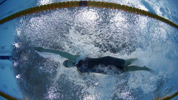 Francesca Halsall of England is seen underwater as she swims in the women's 50m Freestyle final during the 2014 Commonwealth Games in Glasgow