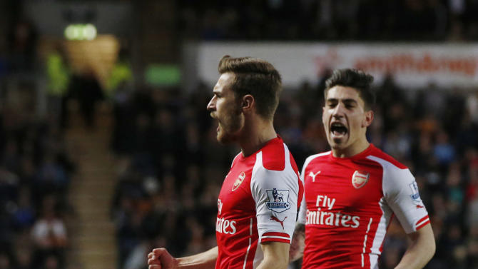 Football: Aaron Ramsey celebrates scoring the second goal for Arsenal with Hector Bellerin
