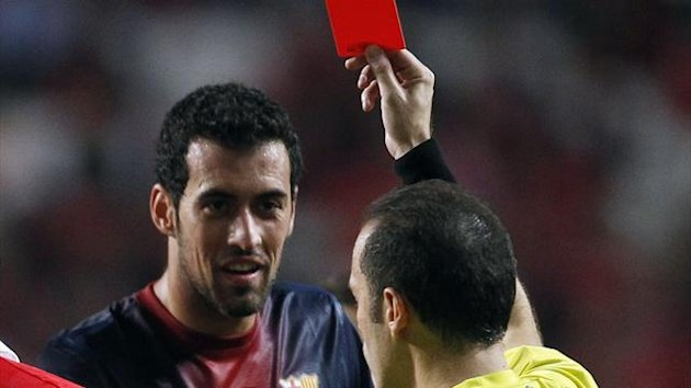 Barcelona's Sergio Busquets (L) receives a red card during their Champions League Group G match against Benfica at the Luz stadium in Lisbon
