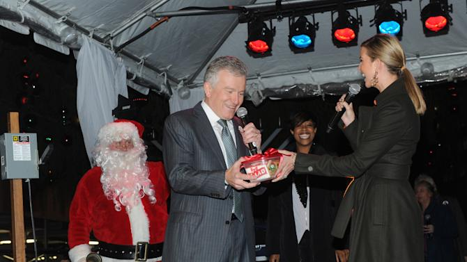 IMAGE DISTRIBUTED FOR GLAD - Ivanka Trump, right, mother and businesswoman, presents holiday cookies to New York Stock Exchange (NYSE) CEO Duncan Niederauer on behalf of The Glad Products Company on National Cookie Day during the 89th annual NYSE tree lighting ceremony, Tuesday, Dec. 4, 2012, in New York.  This holiday season, Glad will make a donation to its longstanding partner Cookies for Kids' Cancer, a nonprofit that raises funds for pediatric cancer research through cookie sales. (Photo by Diane Bondareff/Invision for Glad/AP Images)