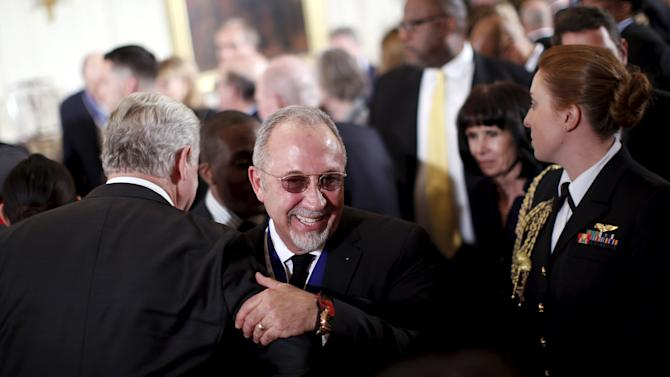 Music producer Emilio Estefan leaves after receiving the Presidential Medal of Freedom during a ceremony in the East Room of the White House in Washington