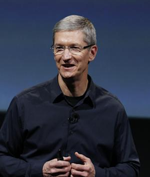 Apple CEO Tim Cook smiles during an announcement at Apple headquarters in Cupertino, Calif., Tuesday, Oct. 4, 2011. (AP Photo/Paul Sakuma)