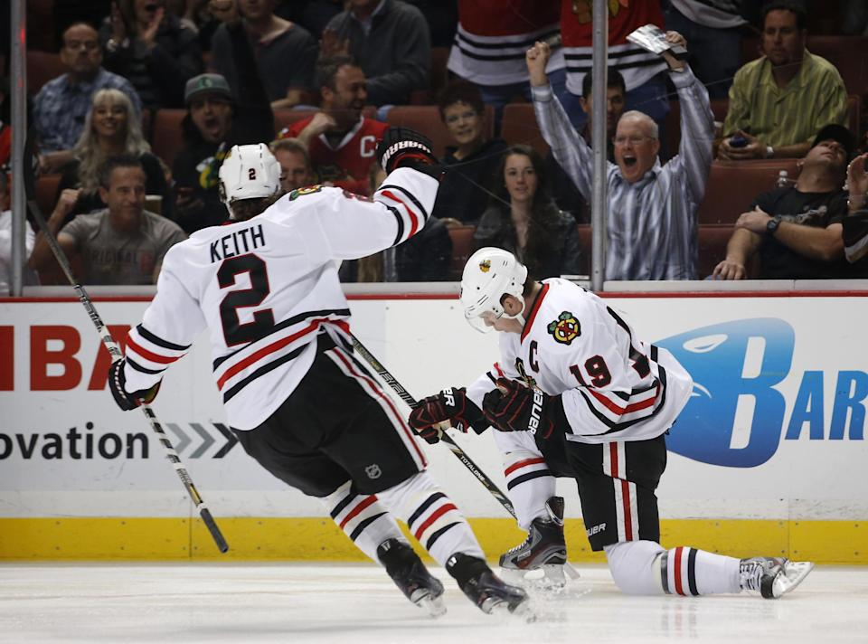 Chicago Blackhawks' Jonathan Toews (19) and Duncan Keith (2) celebrate a goal by Toews during the first period of an NHL hockey game against the Anaheim Ducks in Anaheim, Calif., Wednesday, March 20, 2013. (AP Photo/Jae C. Hong)