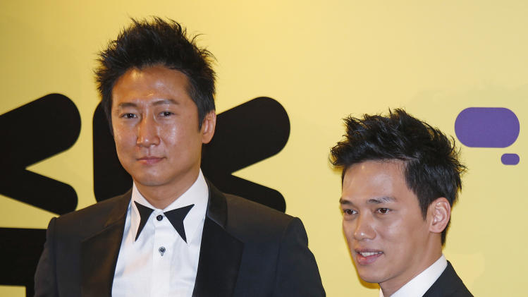 Hong Kong actor Timmy Hung, left, and Marvel Chow pose for photographers at the red carpet of 37th Hong Kong International Film Festival (HKIFF) Grand Opening in Hong Kong Sunday, March 17, 2013. (AP Photo/Vincent Yu)