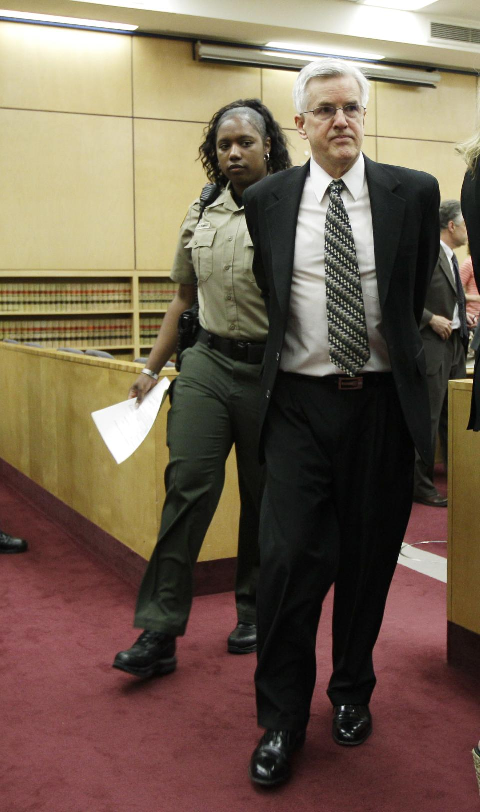 Steve Powell, right, is led from the courtroom after he was found guilty of 14 counts of voyeurism, Wednesday, May 16, 2012, in Tacoma, Wash. Powell is the father-in-law of missing Utah mother Susan Powell. (AP Photo/Ted S. Warren)
