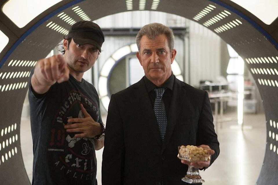 "This image released by Open Road Films shows director Robert Rodriguez, left, with actor Mel Gibson on the set of ""Machete Kills."" (AP Photo/Open Road Films, Rico Torres)"