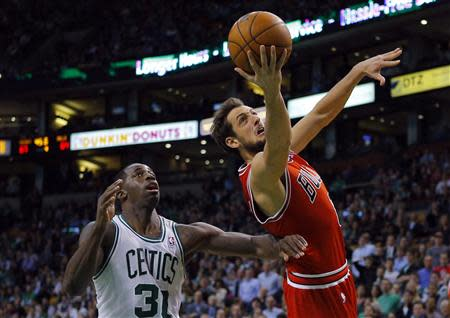 Chicago Bulls guard Belinelli of Italy scores a basket past Boston Celtics forward Bass in the second half of their NBA basketball game in Boston
