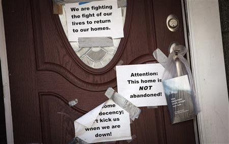 Signs are taped to the front door of a home in the New Dorp Beach area in the Staten Island borough of New York