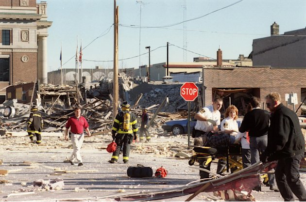 In this Dec. 11, 1998 photo, emergency personnel helping a victim of a gas explosion that killed four and leveled six buildings in downtown St. Cloud, Minn. An Associated Press investigation has found