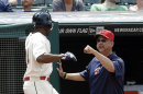 Cleveland Indians manager Terry Francona, right, congratulates Michael Bourn after Bourn scored on a fielders choice by Asdrubal Cabrera in the seventh inning of a baseball game, Monday, May 20, 2013, in Cleveland. (AP Photo/Tony Dejak)