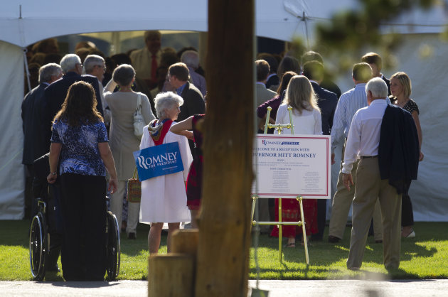 People line up for a fundraiser for Republican presidential candidate, former Massachusetts Gov. Mitt Romney hosted by former Vice President Dick Cheney on Thursday, July 12, 2012 in Wilson, Wyo.  (AP