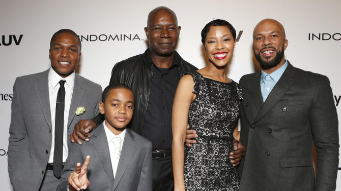 "Director Sheldon Candis, Michael Rainey Jr., Dennis Haysbert, Tracey Heggins and Common attend the LA premiere of ""Luv"" at the Pacific Design Center on Thursday, Jan. 10, 2013, in West Hollywood, California. (Photo by Todd Williamson/Invision/AP)"