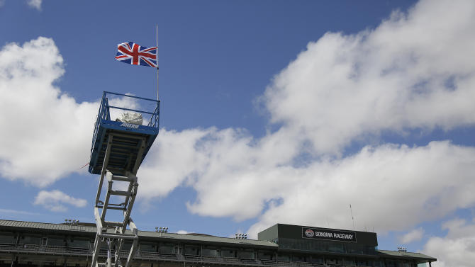 A British flag flies at half-staff on a television tower in tribute to Justin Wilson during practice for the IndyCar auto race Saturday, Aug. 29, 2015, in Sonoma, Calif. Wilson, of Great Britain, died Aug. 24 from injuries sustained at Pocono Raceway. (AP Photo/Eric Risberg)