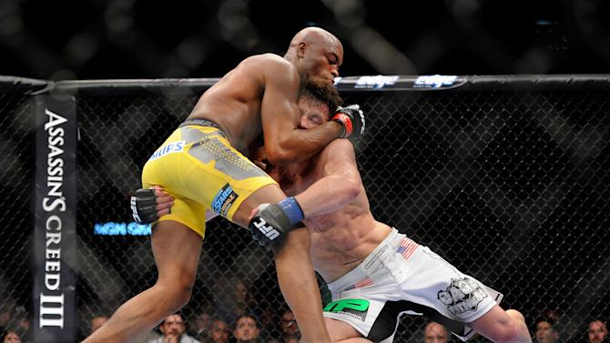 Anderson Silva, left, and Chael Sonnen battle it out during their UFC 148 middleweight championship fight at the MGM Grand Garden Arena Saturday, July 7, 2012 in Las  Vegas. Silva won with a TKO in the second round. (AP Photo/David Becker)