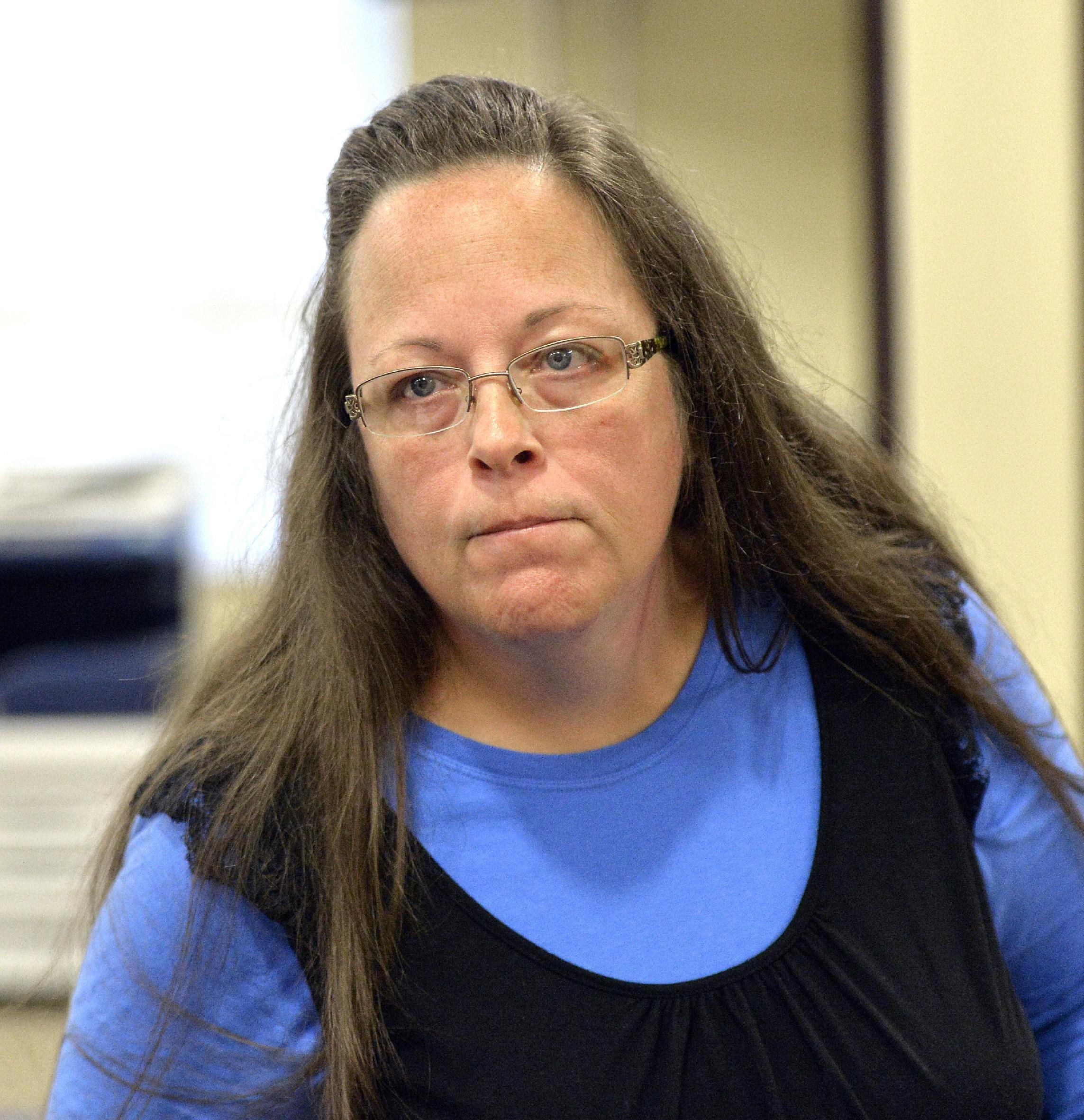 Clerk in gay marriage fight once unlikely to wage moral war