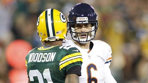 Chicago Bears quarterback Jay Cutler talks with Green Bay Packers cornerback Charles Woodson (Reuters)
