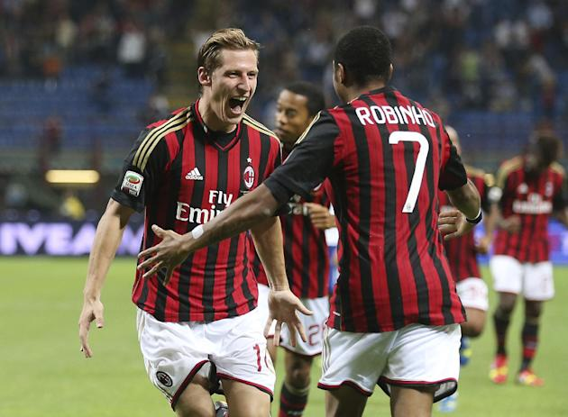 AC Milan midfielder Valter Birsa, left, of Slovenia, celebrates with his teammate  Brazilian forward Robinho after scoring during the Serie A soccer match between AC Milan and Sampdoria at the San Sir