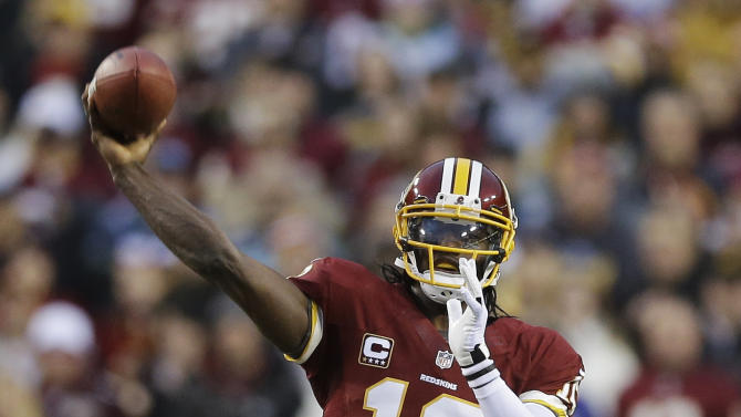 Washington Redskins quarterback Robert Griffin III throws the ball during the first half of an NFL wild card playoff football game against the Seattle Seahawks in Landover, Md., Sunday, Jan. 6, 2013. (AP Photo/Matt Slocum)
