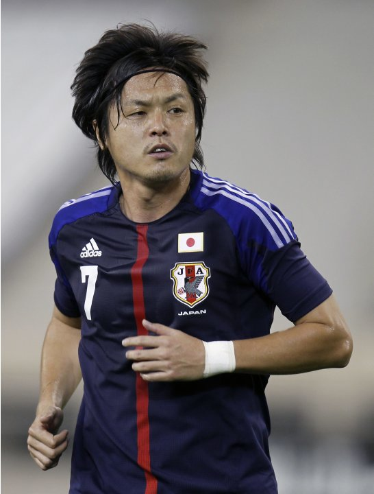 Japan's Endo runs during their international friendly soccer match against Canada in Doha