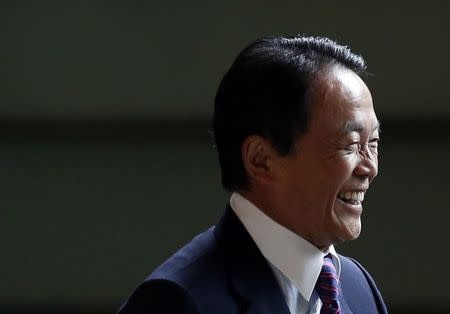 Japan's Deputy Prime Minister and Finance Minister Taro Aso smiles as he arrives at Prime Minister Shinzo Abe's official residence in Tokyo
