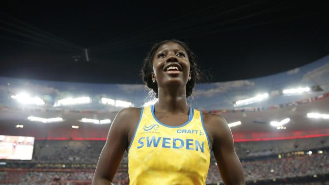 Sagnia of Sweden speaks to her coach during women's long jump final at 15th IAAF World Championships in Beijing