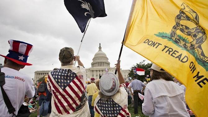 In this June 19, 2013, photo, Tea Party activists attend a rally on the grounds of the Capitol in Washington, Wednesday, June 19, 2013. Six months after Hispanics overwhelmingly helped return President Barack Obama to office and control of the Senate to Democrats, House Speaker John Boehner is the face of the GOP effort to bite into that base of support _ or at least stop alienating a demographic that accounts for 17 percent of the nation. That means getting a new policy on immigration, perhaps the most delicate political dance of Boehner's career. (AP Photo/J. Scott Applewhite)