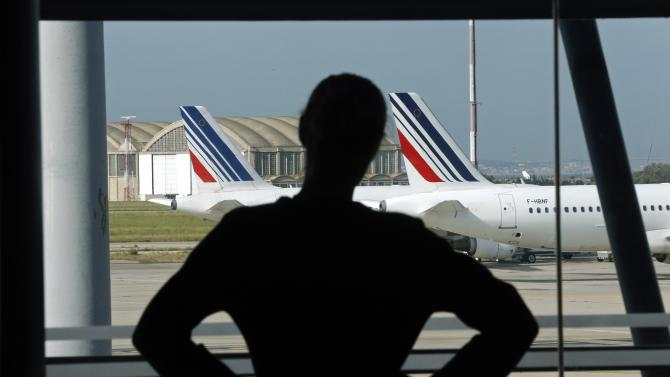 An Air France staff member looks at the Marseille-Provence airport tarmac on the second day of an Air France one-week strike at Marseille airport