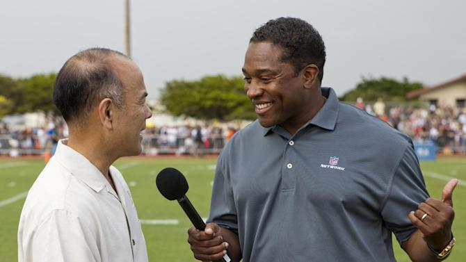 Ret. Major General Jason Kamiya, Senior Vice President at USAA, left, is interviewed by Fran Charles of the NFL Network during NFL Pro Bowl Practice at Joint Base Pearl Harbor Hickam, Thursday, Jan. 24. 2013 in Honolulu.  (Marco Garcia/AP Images for USAA)