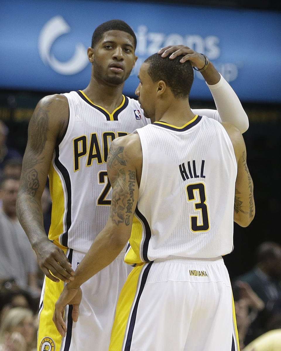 Indiana Pacers' Paul George, left, is congratulated by teammate George Hill following a scramble for a loose ball during the second half of Game 1 in the first round of the NBA basketball playoffs against the Atlanta Hawks, Sunday, April 21, 2013, in Indianapolis. Indiana defeated Atlanta 107-90. (AP Photo/Darron Cummings)