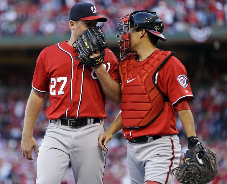 Washington Nationals starting pitcher Jordan Zimmermann, left, talks with catcher Kurt Suzuki as they walk off the field at the end of the second inning in Game 2 of baseball's National League division series against the St. Louis Cardinals, Monday, Oct. 8, 2012, in St. Louis. (AP Photo/Jeff Roberson)
