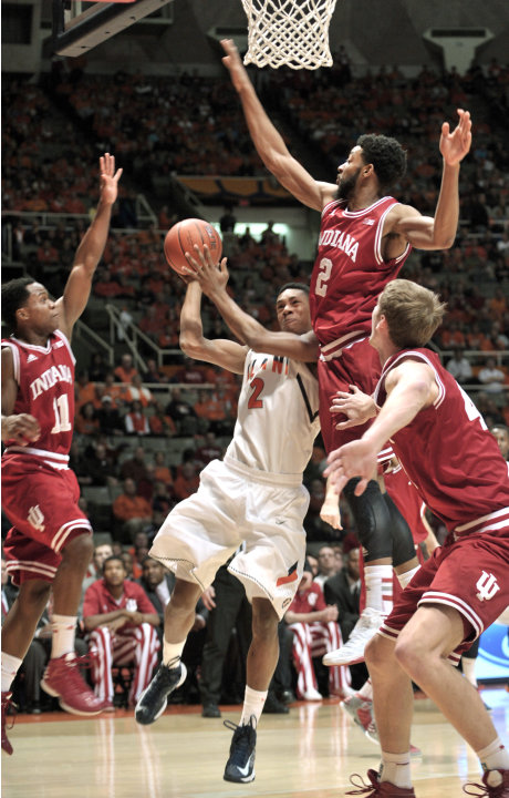 "Illinois' Joseph Bertrand (2) tries to get to the basket between Indiana's Kevin ""Yogi"" Ferrell (11), Christian Watford (2) and Cody Zeller (40) during the first half of an NCAA college basketball gam"