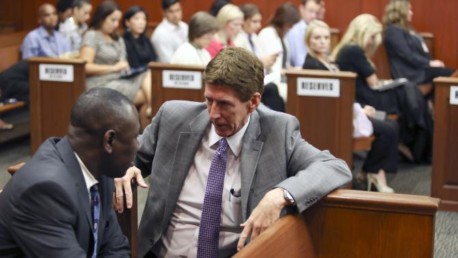 Mark O'Mara, right, George Zimmerman's defense attorney, speaks with Benjamin Crump, the Trayvon Martin family's attorney, during Zimmerman's trial in Seminole circuit court in Sanford, Fla., Friday, June 14, 2013. Zimmerman has been charged with second-degree murder for the 2012 shooting death of Trayvon Martin.(AP Photo/Orlando Sentinel, Gary W. Green, Pool)