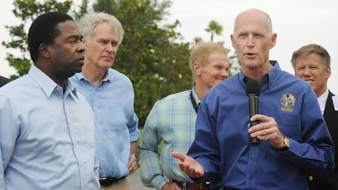 Jacksonville Mayor Alvin Brown, left, Rep. Ander Crenshaw, R-Fla., and Sen. Bill Nelson, D-Fla., listen as Florida Gov. Rick Scott, right, speaks during a news conference about the effects of Tropical Storm Beryl on the Northeast Florida area in Jacksonville, Fla., Monday afternoon, May 28, 2012.(AP Photo/The Florida Times-Union, Kelly Jordan)