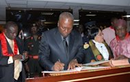 Ghana's Vice President John Dramani Mahama signs documents after taking the oath of office as head of state in Accra. Ghana was plunged into mourning after the sudden death of president John Atta Mills five months ahead of elections in the country seen as a bastion of democracy in west Africa