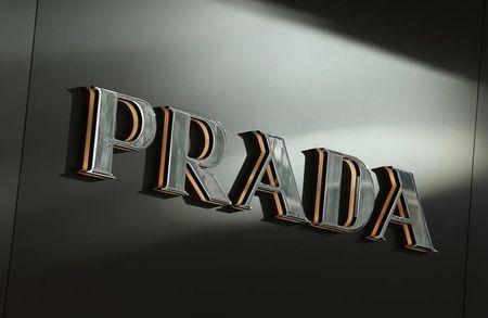 Prada to pamper clients to prop up sales as 2014 net falls 28 percent