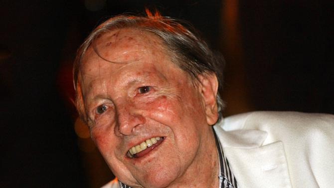 "FILE - In this Friday, May 19, 2006, file photo, artist Robert Rauschenberg smiles during the opening night gala of ""Robert Rauschenberg: Combines"" at the Museum of Contemporary Art, in Los Angeles. Before he died in 2008, pop artist Rauschenberg asked three of his closest friends to oversee his $600 million estate. Now those friends are asking a Florida probate court for trustees fees, $60 million in fees, to be exact. (AP Photo/Ann Johansson, File)"