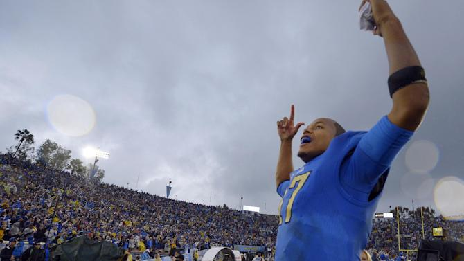 UCLA quarterback Brett Hundley celebrates after they defeated Southern California 38-28  in their NCAA college football game, Saturday, Nov. 17, 2012, in Pasadena, Calif.  (AP Photo/Mark J. Terrill)