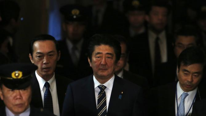 Japan's PM Abe walks to attend upper house committee session at the parliament in Tokyo