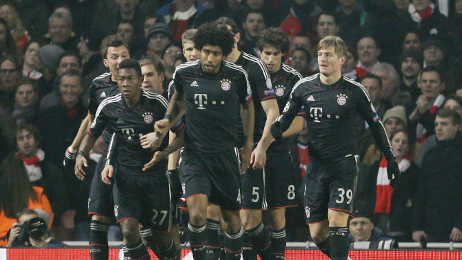 Bayern's Toni Kroos, right, celebrates with his teammates after scoring the opening goal during a Champions League, round of 16, first leg soccer match between Arsenal and Bayern Munich at Arsenal's Emirates stadium in London, Tuesday, Feb.  19, 2013.(AP Photo/Alastair Grant)