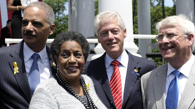 Former President Bill Clinton, second from right, stands with, from left, Attorney General Eric Holder, Myrlie Evers-Williams, the widow of slain civil rights activist Medgar Evers, and Sen. Roger Wicker, R-Miss., following the 50th anniversary remembrance ceremony of Evers' death, Wednesday, June 5, 2013, at Arlington National Cemetery in Arlington, Va. (AP Photo/Susan Walsh)
